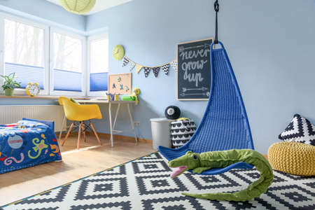 Fun child room arranged in scandinavian style, with work space and fun accessories Stock Photo