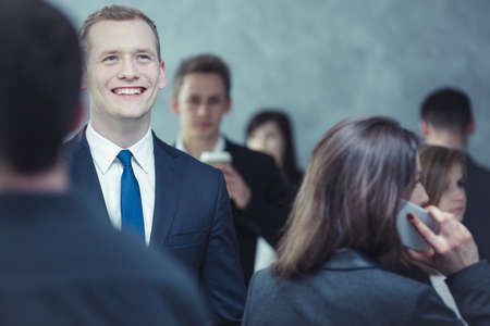 smartly: Close-up of a smartly-dressed, cheerful young man in the crowded place Stock Photo