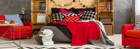 decoration messy: Shot of a modern grey and red bedroom