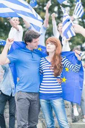 manifest: Young Greeks with flag of European Union
