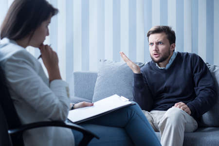 diagnosing: Young experienced psychiatrist diagnosing her patient