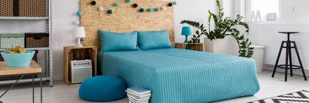 bedroom furniture: Loft design bedroom interior with wooden and metal furniture Stock Photo