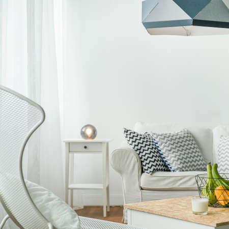 living idyll: Minimalist small studio room in white colour Stock Photo