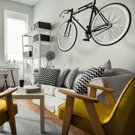 living room wall: Bicycle hanging on the wall in living room