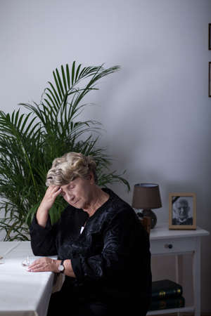 grieve: Elderly widowed lady sitting at home alone