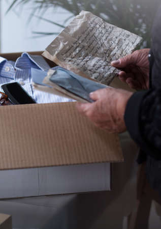 old letters: Old womans keepsakes in a carton box