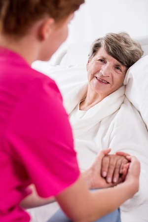geriatric care: Photo of nurse supporting senior patient before operation