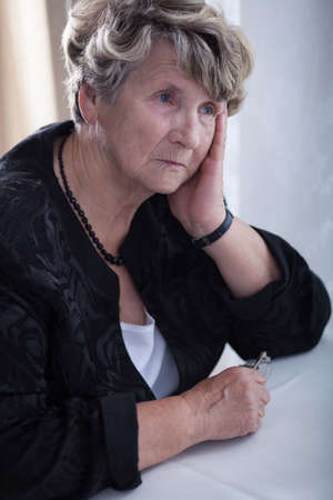 miserable: Sad elderly woman feeling lonely and miserable