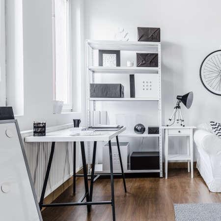 rack arrangement: Trendy minimalist black and white studio flat Stock Photo