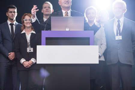 public address: Political candidate at podium speaking and gesturing during press conference Stock Photo