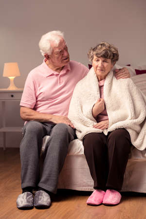 taking a wife: Senior husband taking care of his wife, cozy home interior