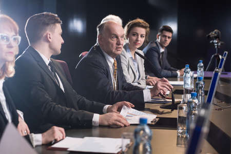 debate: Business people attending seminar, debate or conference Stock Photo