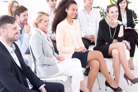 group meeting: Shot of a group of employees sitting on a business meeting
