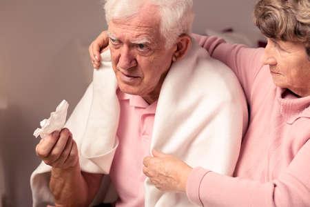 vitality: Senior woman supporting her ill, sad husband Stock Photo