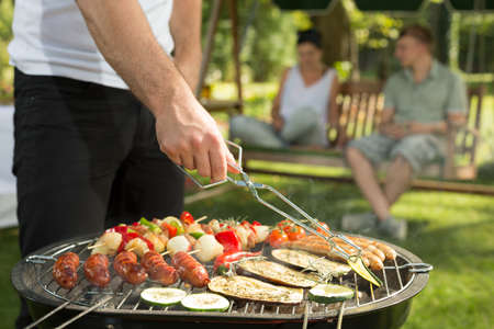 Close-up of barbecue full of fresh tasty food