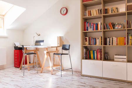 idea comfortable: Shot of a modern study with a desk and a bookshelf Editorial