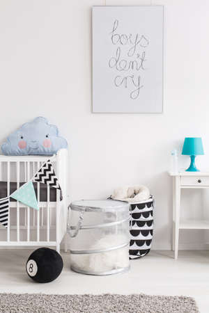 nightstand: Fragment of a cot, containers and a nightstand in a baby room