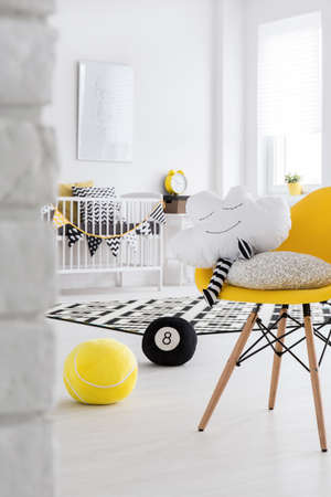 pouffe: Baby room with yellow designer chair and mascot cloud Stock Photo