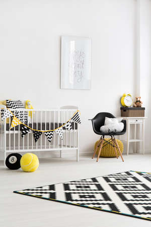 designer baby: Baby room furnished black and white with yellow items