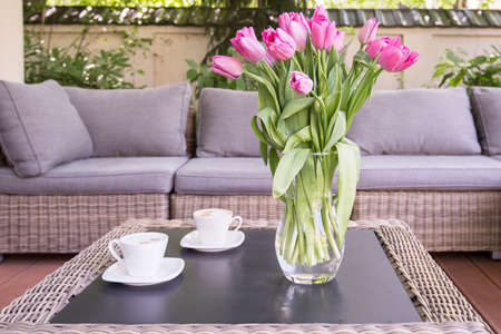 verandah: Bouquet of rose tulips on the table