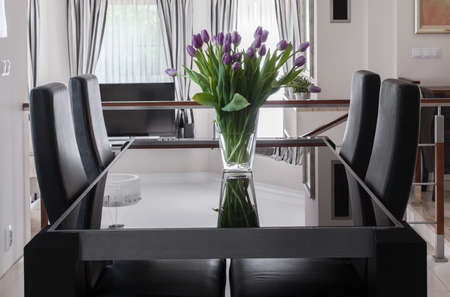 Black dining table and chairs in luxury interior