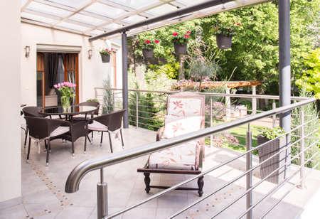 verandah: Cozy verandah with garden furniture and deckchair