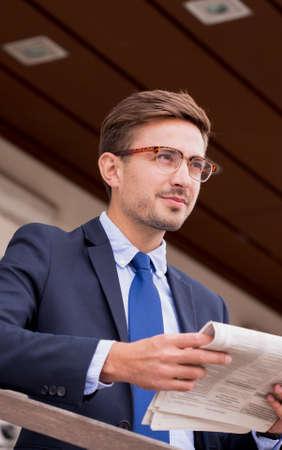 break from work: Young businessman has a break during work Stock Photo