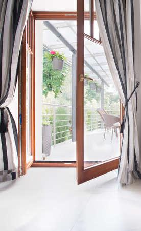 balcony door: Empty interior with open door to the balcony