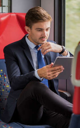 delegation: Young man is traveling by modern train Stock Photo