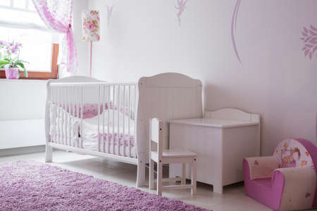 interior room: Interior of white and rose baby room Stock Photo