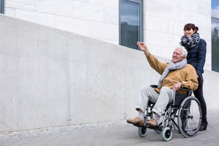 retiree: Photo of disabled retiree spending time outdoors Stock Photo