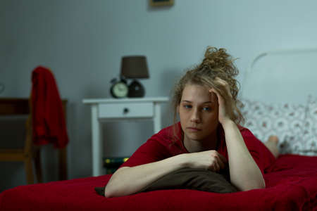 Photo of blonde girl in melancholy alone at home