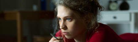 addicted: Panorama of addicted depressed woman living alone