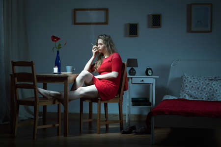 addicted: Image of woman addicted to cigarettes living alone