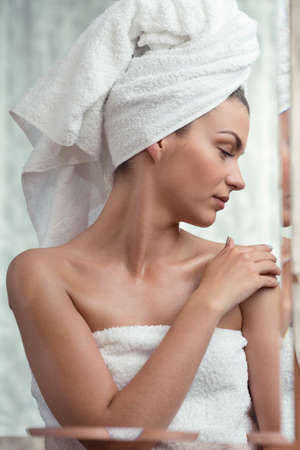 light complexion: Shot of a young woman wearing a towel and having her eyes closed Stock Photo