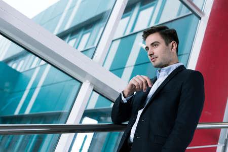 alumnus: Elegant student in suit ready for important exam on modern university