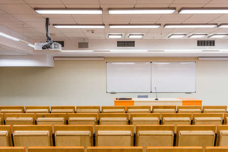 lecture theatre: Modern lecture hall seen from behing the seats Stock Photo