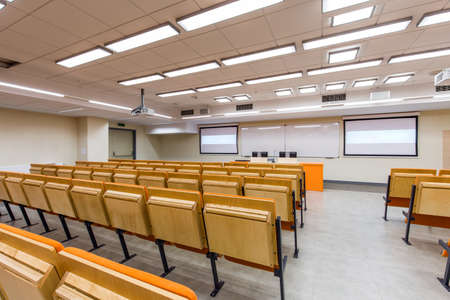 lecture theatre: Medium-sized lecture hall with screens and whiteboard