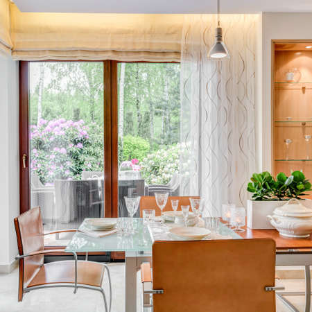 large windows: Modern style dining room with large windows