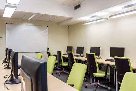 swivel chairs: Computer room with green swivel chairs and whiteboard Stock Photo