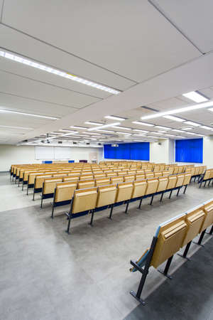 lecture theatre: Minimalist lecture hall with rows of folded seats Stock Photo