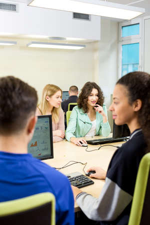 computer science classes: Shot of a group of students participating in an IT class