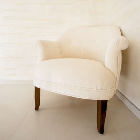 comfortable chair: View of comfortable soft chair in bright interior Stock Photo
