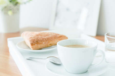 afternoon fancy cake: Puff pastry and cup of coffee prepared on a white tray for breakfast Stock Photo