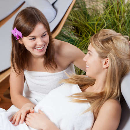 day spa: Two cute girls spending time together at spa Stock Photo