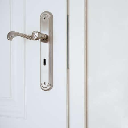 doorhandle: Horizontal view of door-handle in white door