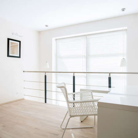 entresol: Bright home office placed on mezzanine floor Stock Photo