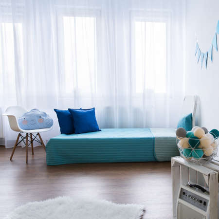 tidy: Tidy modern designed room for boy. Blue elements in white room