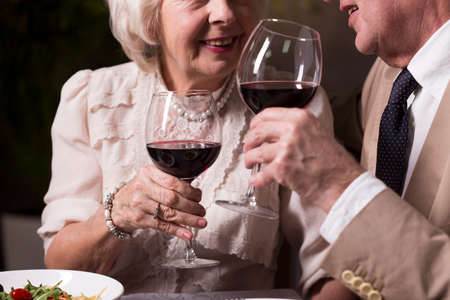 Cropped picture of an elderly couple drinking wine