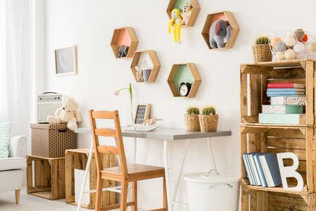 room decor: Shot of a modern childrens room full of wooden furniture